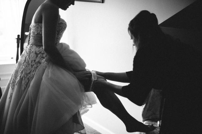 Bride puts on garter