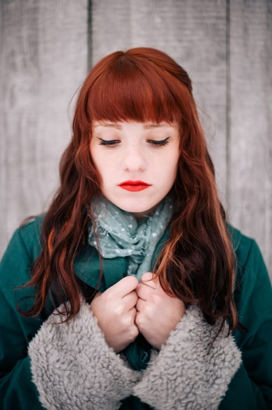 Beautiful red head poses in a snowy setting in a Pittsburgh Suburb (5)