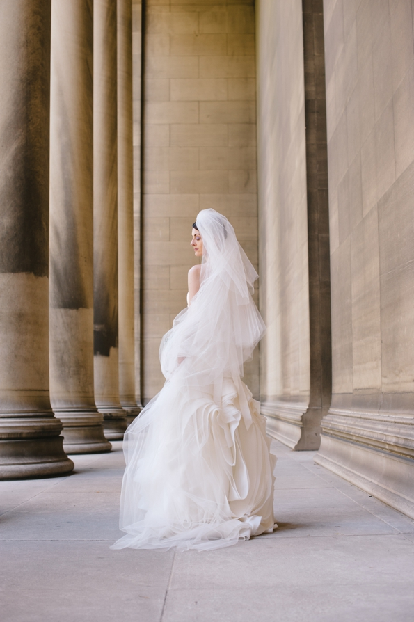 bride stands beautifully beside the pillars of carnegie mellon university