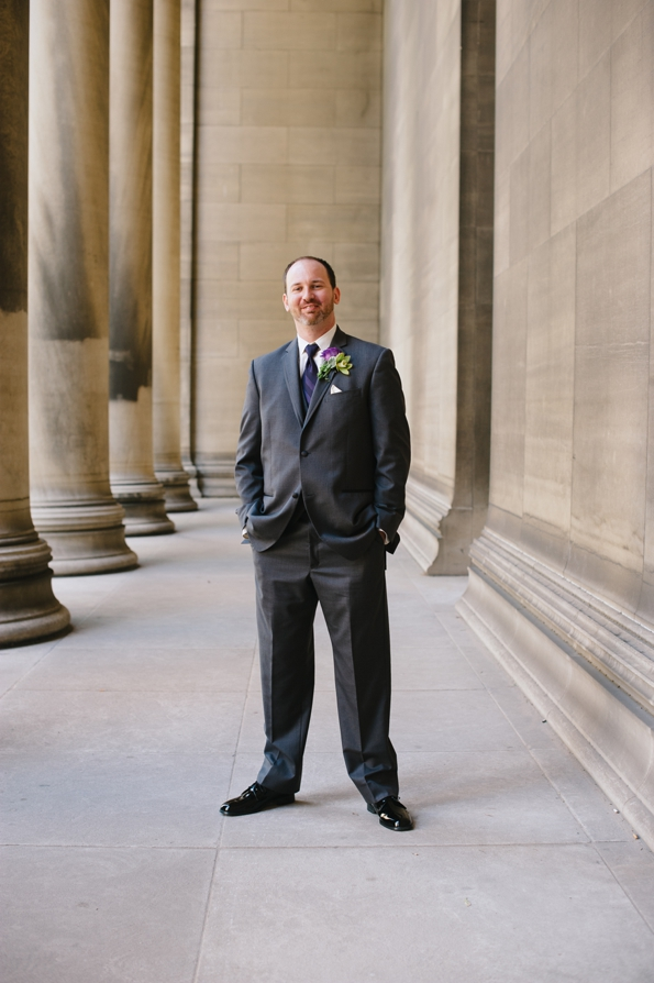 a groom stands in front of carnegie mellon university