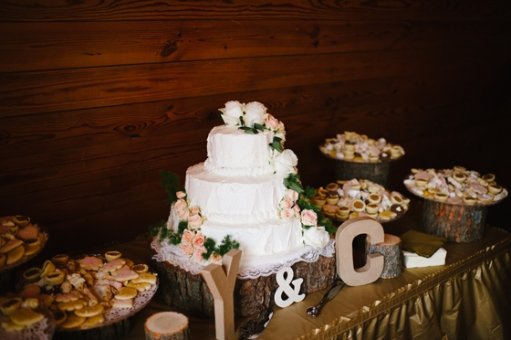 White wedding cake with beautiful fresh flower accents