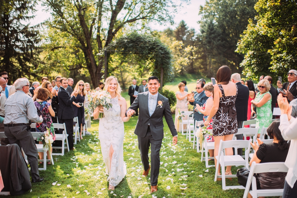 Wedding ceremony aisle with white flower petals