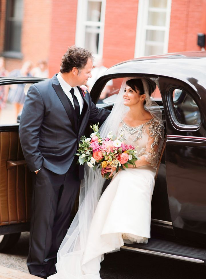 Classic car wedding portrait with bright bouquet