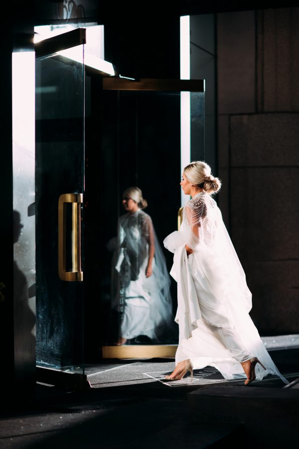 Dramatic photo of a bride walking into Kimpton Hotel Monaco