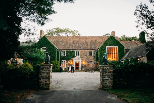 A private grand estate wedding venue with moss covered stone walls