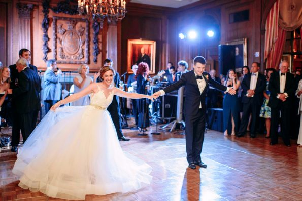 bride and groom sharing their first dancew ith a live band