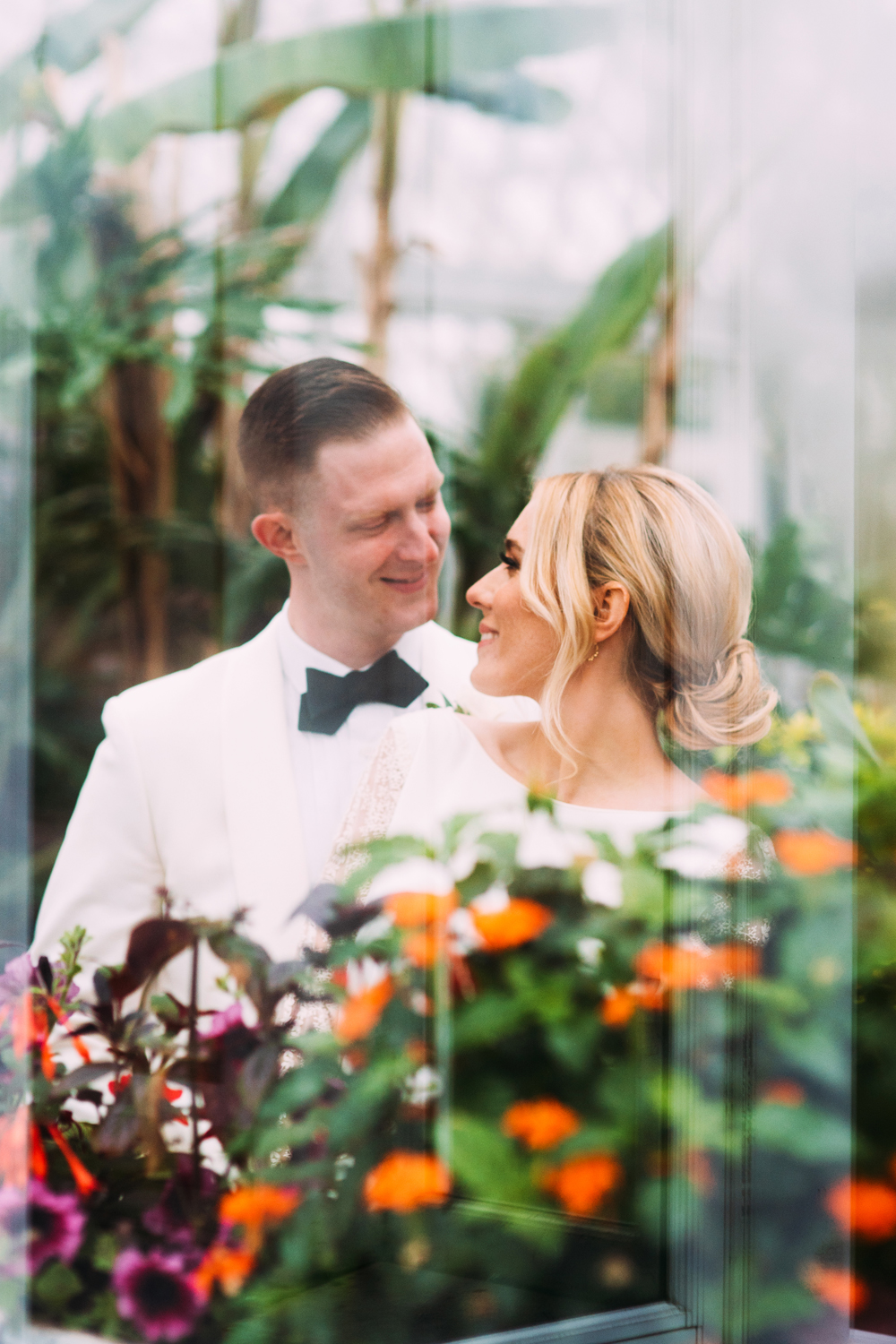 bride and groom standing in the botanical gardens at Phipps conservatory