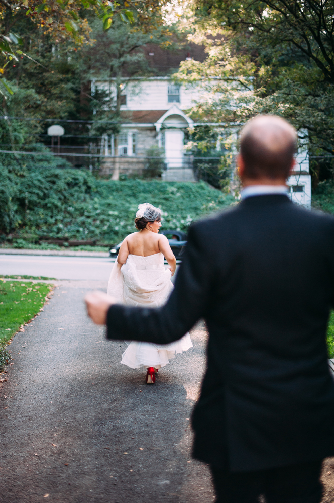 bride playfully running from her groom
