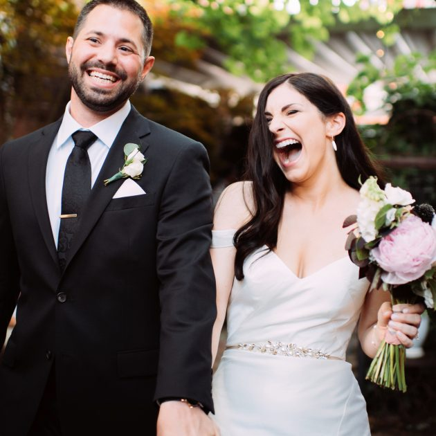 Bride and groom laughing while walking into reception at Morning Glory Inn
