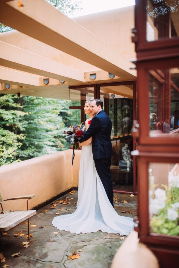 bride and groom at fallingwater