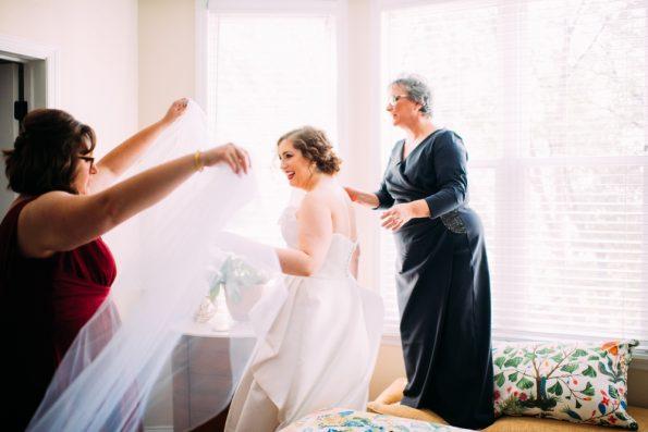 bride putting on veil