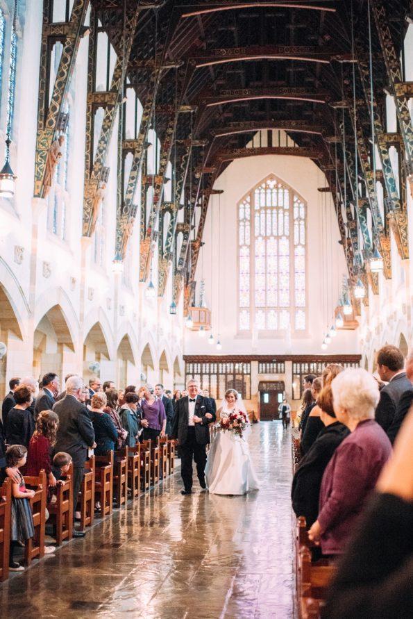 bride walking down aisle at Sacred Heart Parish