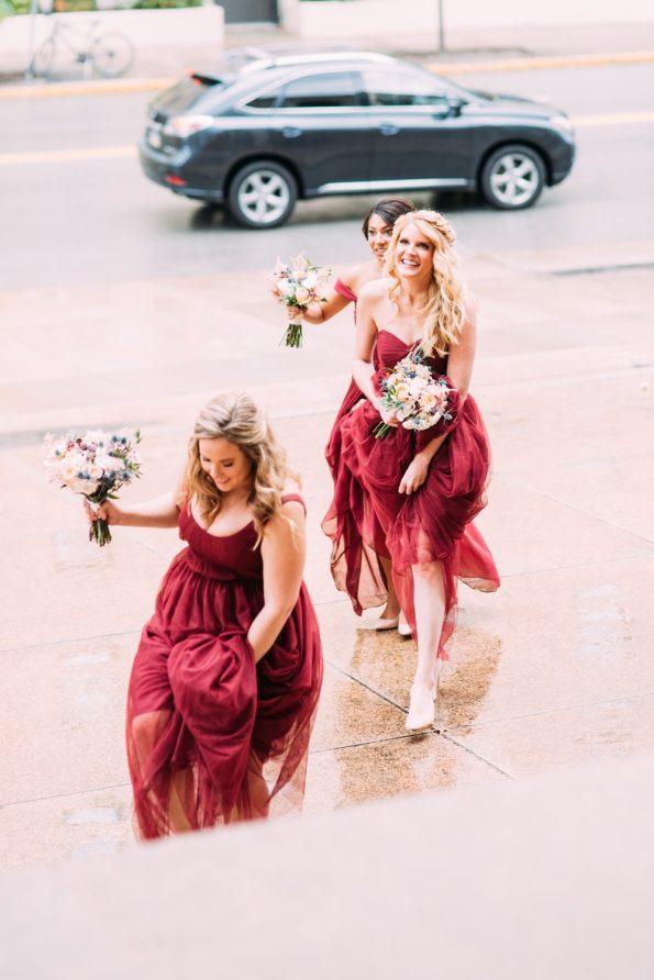 bridesmaids holding dresses
