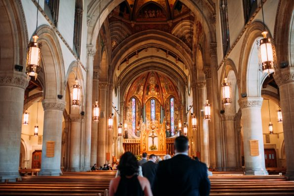wedding guests walking into cathedral wedding ceremony