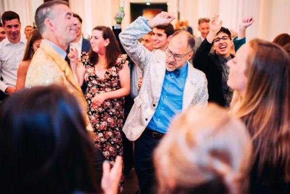 two grooms dancing at Kimpton Hotel Monaco