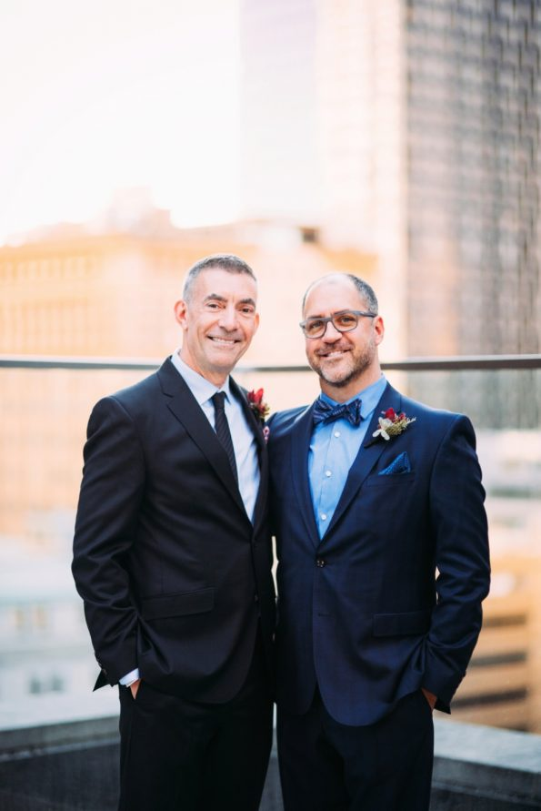 Grooms standing on rooftop at Kimpton Hotel Monaco